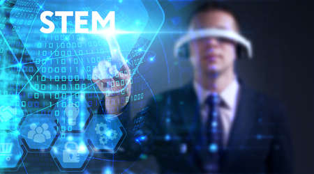 Business, technology, internet and network concept. Young businessman thinks over the steps for successful growth: STEM Stock Photo