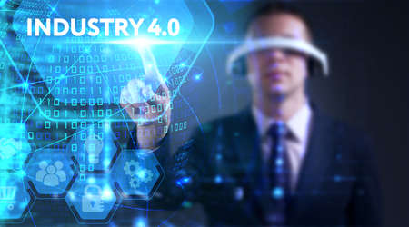 Business, technology, internet and network concept. Young businessman thinks over the steps for successful growth: Industry 4.0 Stock Photo