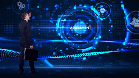 Business, technology, internet and network concept. Young businessman thinks over the steps for successful growth: Assessment