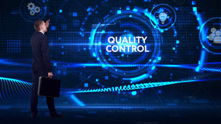 Business, technology, internet and network concept. Young businessman thinks over the steps for successful growth: Quality control