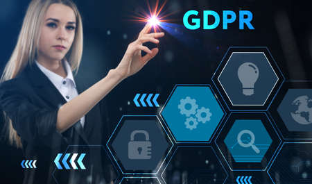 Business, technology, internet and network concept. Young businessman thinks over the steps for successful growth: GDPR Foto de archivo