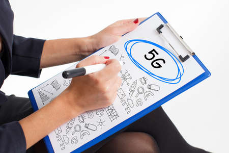 Business, technology, internet and network concept. Young businessman thinks over the steps for successful growth: 5G