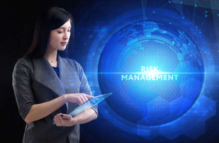 Business, Technology, Internet and network concept. Young businessman working on a virtual screen of the future and sees the inscription: Risk management