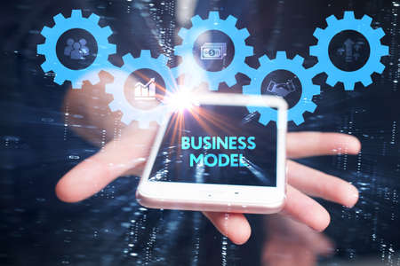 Business, Technology, Internet and network concept. Young businessman working on a virtual screen of the future and sees the inscription: Business model Standard-Bild