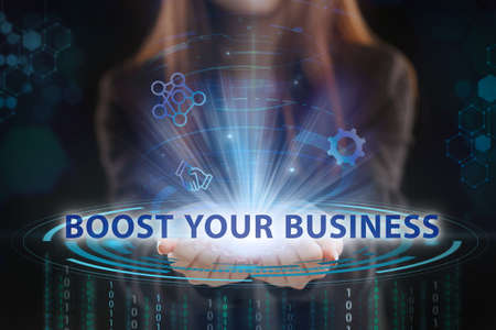 Business, Technology, Internet and network concept. Young businessman working on a virtual screen of the future and sees the inscription: Boost your business 写真素材