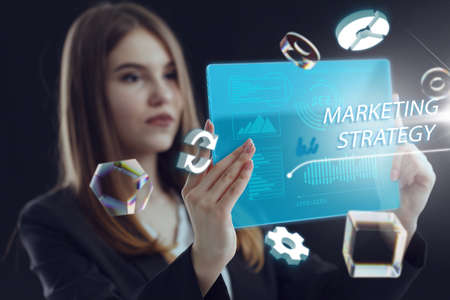 Business, Technology, Internet and network concept. Young businessman working on a virtual screen of the future and sees the inscription: Marketing strategy Archivio Fotografico