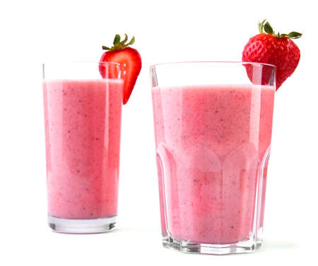 healthful: Two large glasses with pink drinks or beverages from juicy and fresh red strawberries and milk in with a small strawberry in the top of the glass, isolated on a white background.  Fruit beverage with strawberries and milk.