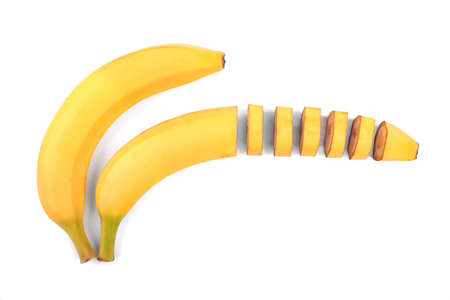 banana skin: Two sweet and fresh bananas. Two bright yellow bananas, one whole banana, and one cut into small pieces. Fresh, tasty, juicy bananas isolated on a white background. Ripe, fresh and sweet bananas Stock Photo