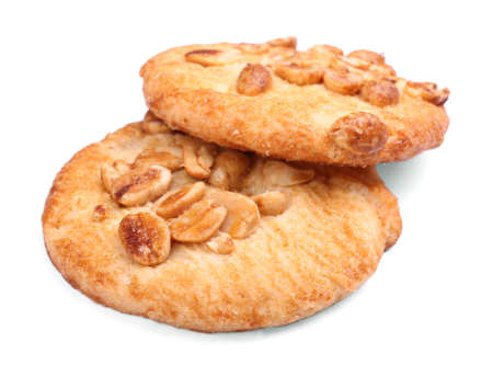 An oatmeal, sweet, homemade cookie. Shortbread cookies. Two oatmeal biscuits, isolated on a white background. Healthy food. Bread products. Sweet cookie. Cereal biscuits.