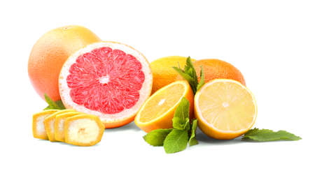 healthful: A group of fresh bright fruits and green mint leaves isolated over the white background. Red raw grapefruit, nutritious yellow lemon, sliced colorful oranges.