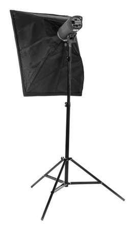 A long and black stripsoft box, isolated on a white background. Photo equipment. Professional studio flash with soft-box. Studio lighting.  Outbreak. Stock Photo