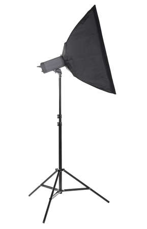A stylish strip softbox for a photo studio, isolated on a white background. Professional photographic technology. A new saturated black tripod. High resolution.