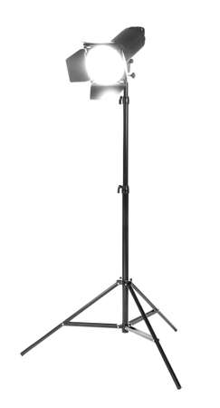Studio lighting on a tripod stand, isolated on a white background. Professional studio equipment. Searchlight for cinema. Making movie single icon in black style bitmap.