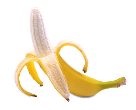 banana skin: A peeled bright yellow banana isolated over the white background. Vegetarian lifestyle concept. A single open banana for a sweet breakfast. Vitamins, dieting and health concept.
