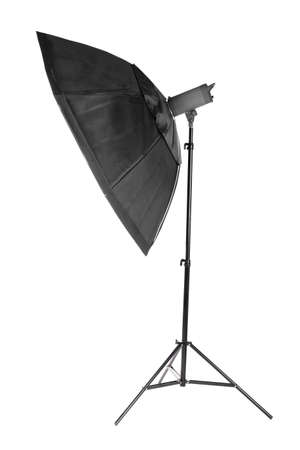 A modern electric saturated black octobox on a tripod. A huge octobox isolated over the white background. Equipment for photogrphers. Professional shooting in a photostudio.