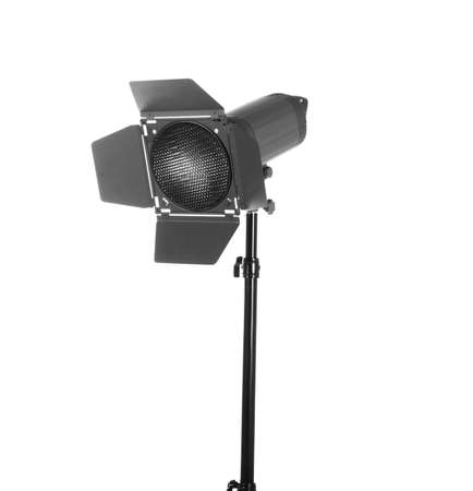 Modern powerful photographic flash. Studio lighting, isolated on the white background. Professional black equipment. Studio photography video light. A long tripod.