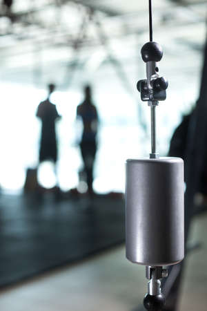 Close-up of a calibration weight on a blurred gym background. Heavyweight measurement equipment for gyms. Copy space. Stock Photo