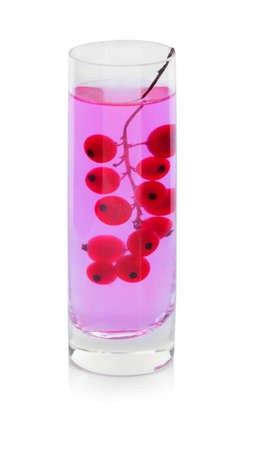 cutted: A twig of bright red currant in a glass with water, berries for refreshing cocktails isolated on a white background.