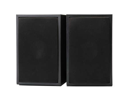 A close-up of black simple loudspeakers isolated on a white background. Audio equipment for sound quality. Stock Photo