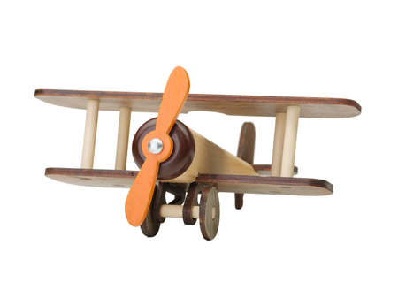 Wooden toy airplane isolated on white, close-up of an eco-friendly product for childrens games, isolated on a white background. A developing toy airplane. Fight simulation.