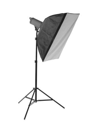A professional softbox isolated over the white background. Photographic equipment for professionals. A dark black studio softbox on a long metal tripod. Photographic technique. Stock Photo