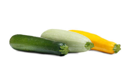 Image of three different colors fresh zucchini fruit isolated on white background.