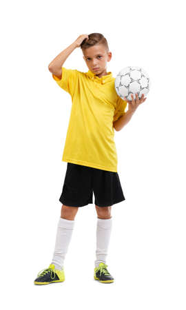 star field: Young boy playing football isolated on white background. Sport concept.