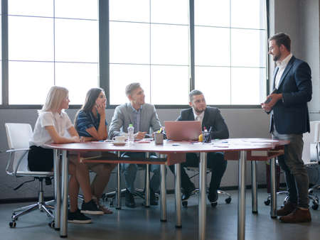 Business consultants while working in a team.A group of young workers at a meeting in the company conference room. Business concept. Stock Photo