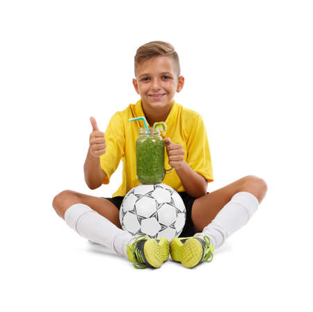 Young boy playing football isolated on white background. Sport concept.