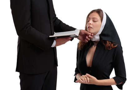 Priest and nun in black suits isolated on a white background.