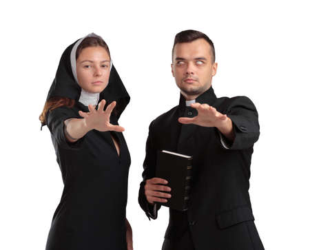 Evil priest and nun isolated on a white background.