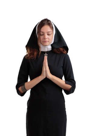 Pretty young nun in religion concept isolated on a white background.