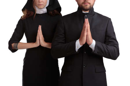 Nun and priest praying isolated on a white background.