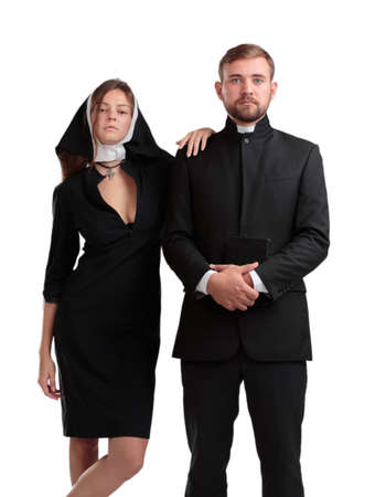 Catholic priest and nun isolaed on a white background.