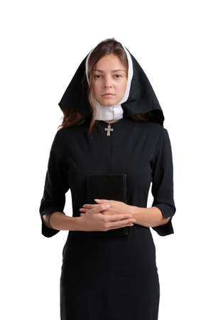Pretty religious nun in religion concept isolated on a white background. Stock Photo