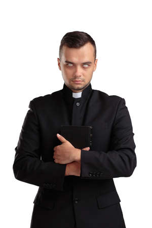 Evil priest with the Bible isolated on a white background.
