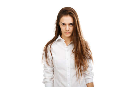 Portrait of a young angry girl on a white background Stock Photo - 87644020