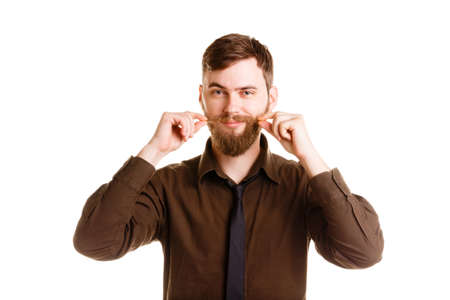 hands in pocket: Handsome man with beard posing and standing isolated on a white background. Stock Photo