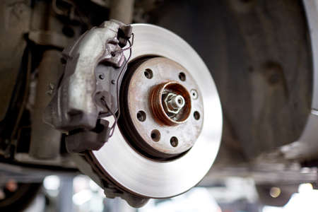 Disc brakes of the car close-up after use Stock Photo