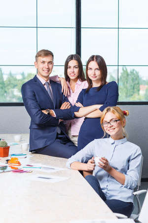 Team of business, friendly office workers in a working office premise