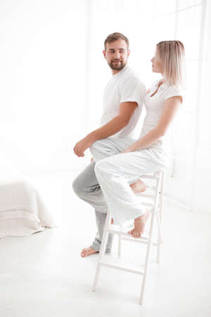 sexual intimacy: Sensual young couple together in bed. Happy couple in bedroom on a white background. Stock Photo