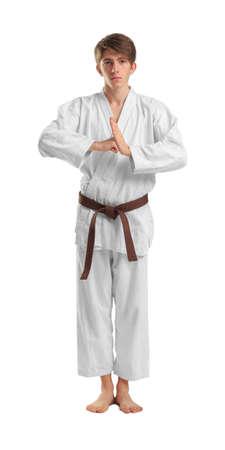 Young sporty man in kimono on white background. Stock Photo
