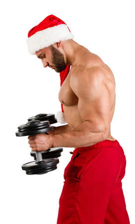 Muscular Santa Claus doing exercises with dumbbells, isolated on white background