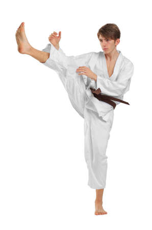 Young guy karatek with brown belt on white isolated background