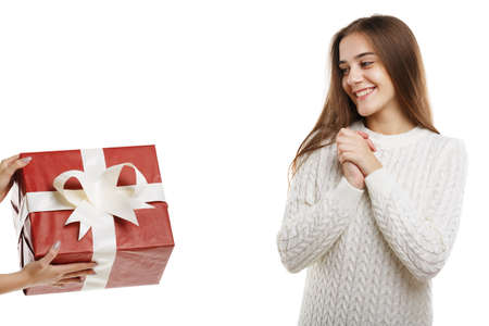 Wow. An excited young cute girl receives a gift.