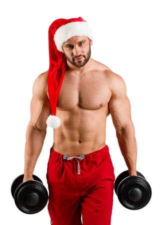 흰색 배경에 빨간색과 흰색 크리스마스 산타 모자 서에서 근육 시체와 함께 혼자, 몸통, 성적 및 강한 젊은 새 해 남자 스톡 콘텐츠
