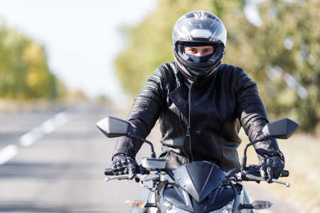 rejas de hierro: A close-up of a motorcycle stands on the road with its owner alone