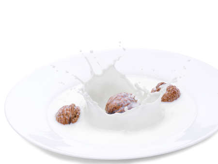 Walnuts falling in a bowl with milk. Isolated photo on a white background. A drop of milk. frozen time
