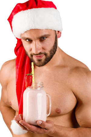 Sexy Christmas man posing on the camera isolated on a white background. Stock Photo