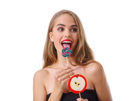 Portrait of a happy girl, with lollipops. Isolated on white background.